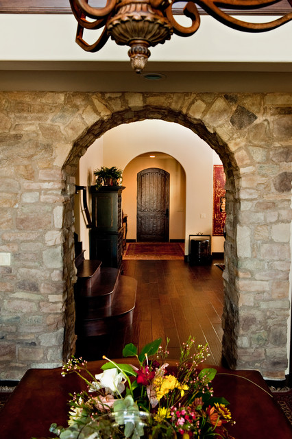 Rustic Stone Archway rustic-dining-room