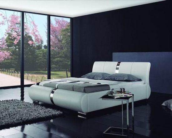 Regina Modern Leather Bed Frame - Supple genuine leather accented by eye catching detail work in the headboard and foot board create the perfect addition to your stylish bedroom decor in the Regina Modern Leather Bed Frame