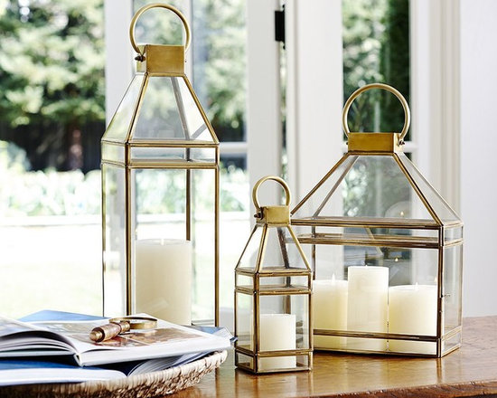 MEREDITH BRASS LANTERNS - Like ship lanterns of old, ours has clear glass walls to shield the candle from summer breezes.