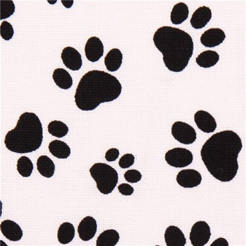 White animal fabric with black paw prints dog fabric