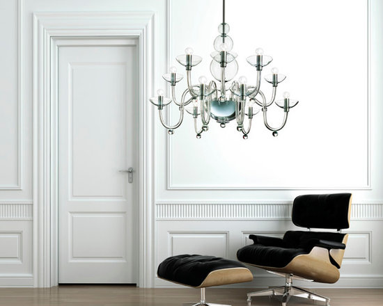 Danieli Chandelier by Leucos - Danieli Chandelier by Leucos. This classic chandelier is an example of true craftmanship. Intricate yet sleek glasswork comprises the unique frame of the Danieli chandelier from the central metal and hand made glass bowl, cleanly curving arms culminate bowl-shaped light holders. Available in crystal glass with polished chrome structure. Companion wall sconce as well as a smaller size chandelier also available. Danieli Chandelier by Leucos are designed by Ufficio Stile Gallery Vetri d'Arte.