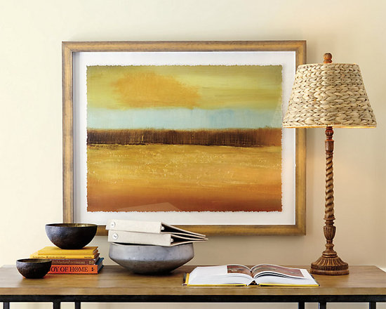 Ballard Designs - Golden Cloud Framed Print - Printed on fine art paper. Wood frame with painted gray edge. Glass front. Working in her studio perched on cliff in Suffolk, England, artist Caroline Gold captures the fleeting effect of light on the natural landscape. In this semi-abstract, the landscape joins with cloud-filled sky in a palette of glowing golds, spa blue and bark. Deckled edge print is floated on a cream background. Golden Cloud Print features:. . .