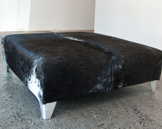 Gorgeous Creatures New Zealand - Dark grey square cowhide ottoman with aluminium legs - A large square dark grey speckle cowhide ottoman 85cm x 85cm x 34cm tall with low aluminium legs.