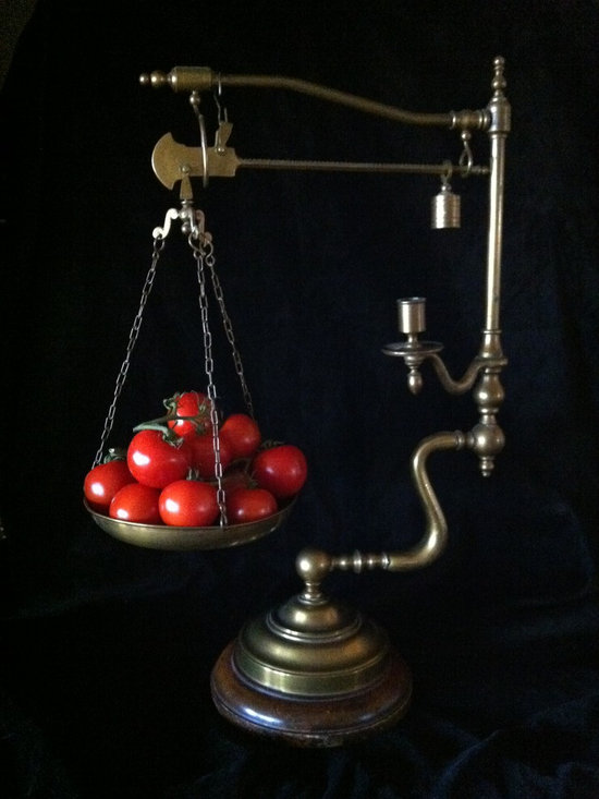 Scale - The accessories we choose can be used in many ways.  While this scale could stand alone beautifully, it now has a function.  Both the scale and tomatoes become a focal point in any kitchen.