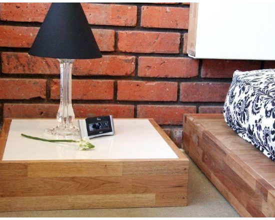 MASHstudios Side Table - Sometimes, a low, flat block is all you need. A hole in the center of this Side Table by MASHstudios cleans up nicely by guiding wires and cords underneath and out of sight.