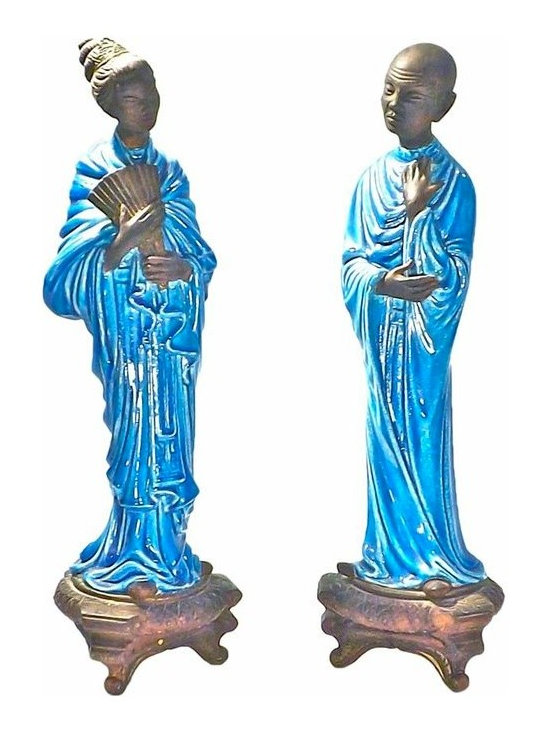 Chinoiserie Figurines - Pair of large Italian-made Mid Century Modern chinoiserie ceramic figurines depicting a man and a woman in blue glazed traditional attire. Head, hands, feet, and base are painted textured dark brown.