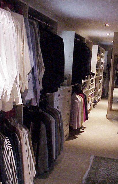 Antique White Master Bedroom Closet closet-organizers