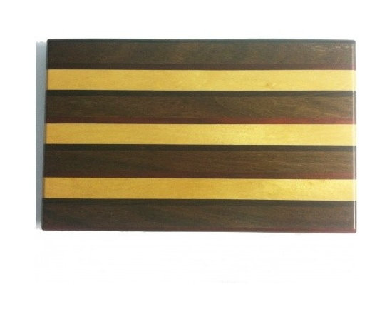 """Exotic Chopping Blocks - 8"""" x 12"""" Cutting Board - This design was created for those with a colorful eye looking for a subtle touch. With the way this board varies in think and thin pieces, the nuances of this board bring the colors to life. The woods used in this board include yellow heart and Padouk from South America and Ebony from Africa. All the woods are their natural colors. There has been no paint or stain added."""