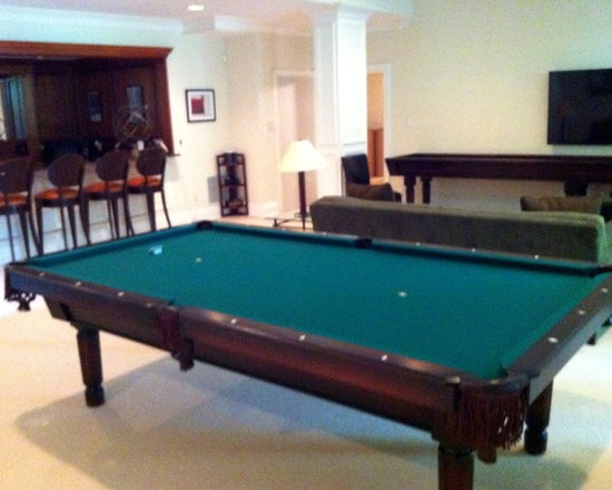 Michigan Made Custom Pool Tables - Add a completely custom made McClure pool table to your bachelor pad and you will forever be happy. Made with one hundred percent North American hard maple wood, this table exudes a unique contemporary style. Not only will this be a focal point of your basement but it will also provide entertainment for you and your friends and family.
