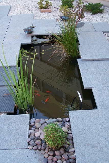 Modern indoor and outdoor water features and fountains for Contemporary garden ponds