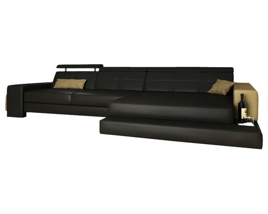 Scene Furniture - Nouvelle Sectional - This small modern leather sectional is designed with several cool features such as a roll-out ottoman and a built-in side light. 16 colors are available to mix and match with.