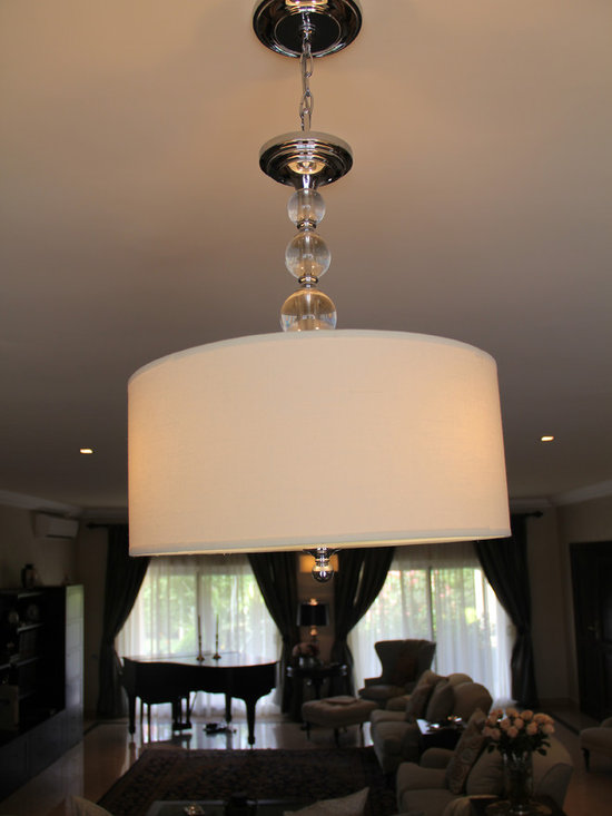 Trasacco 1 - Two glass ball and linen drum chandeliers span from the upper dining room and down into the living room