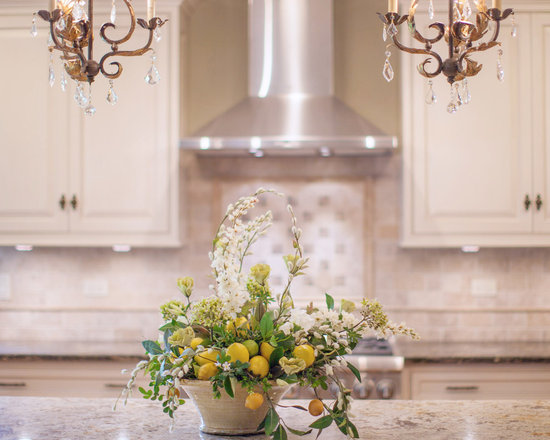 Lemon Arrangement in Ceramic Container - Fruit and flowers go so well together. Add this lemon floral arrangement to brighten up your kitchen!
