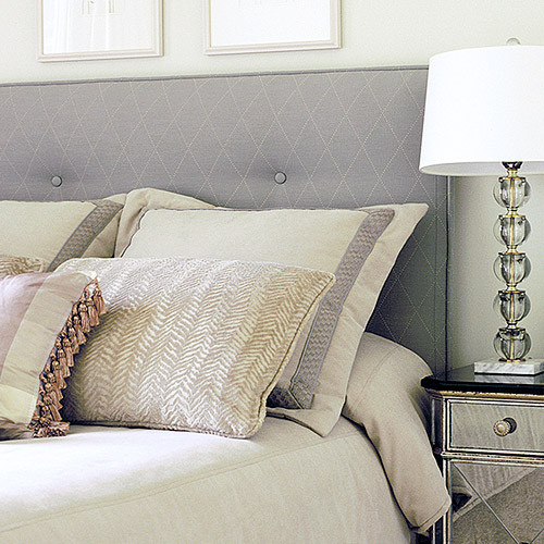 Upholstered fabric headboard in calming grey tones with custom pillows traditional headboards