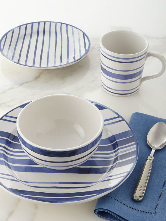 """Ralph Lauren - 4-Piece Cote D'Azur Stripe Dinnerware Place Setting - BLUE/WHITE - Ralph Lauren4-Piece Cote D'Azur Stripe Dinnerware Place SettingDetailsStoneware.Painted design.Dishwasher microwave oven and freezer safe.Place setting includes 11""""Dia. dinner plate 8.5""""Dia. side plate 5.5""""Dia. x 3""""T bowl and 4""""Dia. x 4.25""""T mug.Imported.Designer Please note: items that are part of the Ralph Lauren Home Collection are not available at any discount and will be removed from our site during sale events.About Ralph Lauren Home:The first designer to create an all encompassing collection for the home Ralph Lauren Home debuted in 1983 and provides a comprehensive lifestyle experience featuring complete luxurious worlds. Whether inspired by timeless tradition or reflecting the utmost in modern sophistication each of the collections is distinguished by the enduring style and expert craftsmanship of Ralph Lauren. With creative vision and impeccable design Ralph Lauren Home offers both transporting seasonal collections and enduring classics. Inspiration is drawn from English country estates the natural tones and textures of the desert or the spirit of adventure embodied in Safari the romance of seaside living the faded florals and classic ticking stripes of American country or the sleek urban aesthetic of a city loft. The line includes bed and bath linens china crystal silver decorative accents and gifts as well as lighting and furniture."""