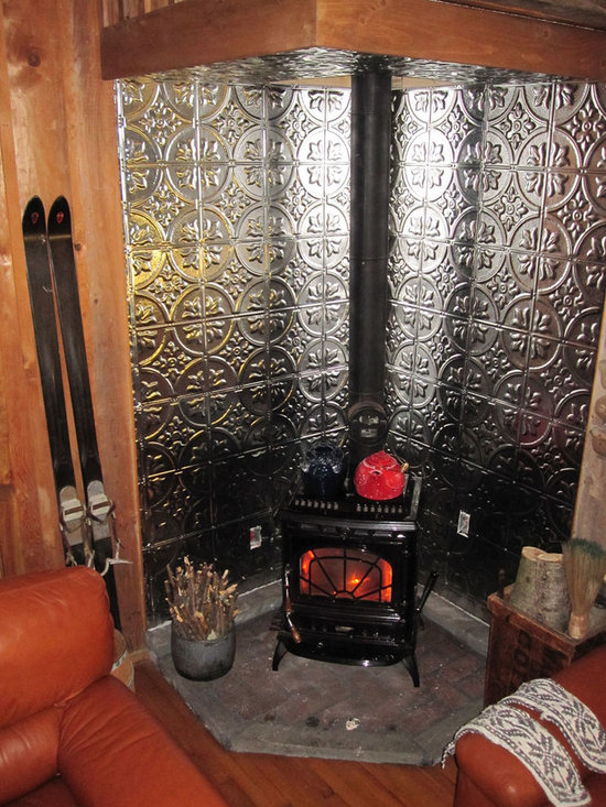 Antique Fireplace Surround with Tin Tiles - Pattern 2 Stainless Steel creates a beautiful wall to house an antique fireplace. The tiles are suitable for areas that endure high temperatures.