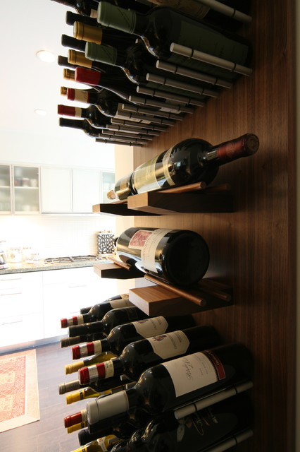 wine wall series in walnut modern wine cellar