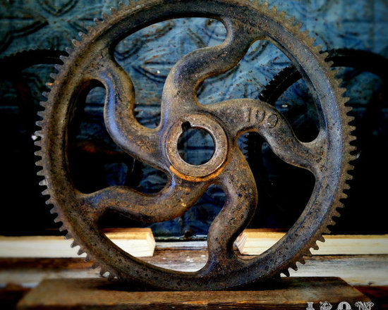 """Antique Industrial Gear Decor - Antique numbered gear of cast iron in a very dynamic industrial style! Luscious old patina with its original black painted finish. Marked: 100. Sits in a rustic reclaimed lumber display stand. 8.25"""" diameter."""