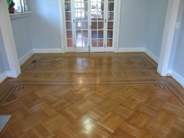 Historic oak parquet with decorative border traditional for 1930s floor tiles