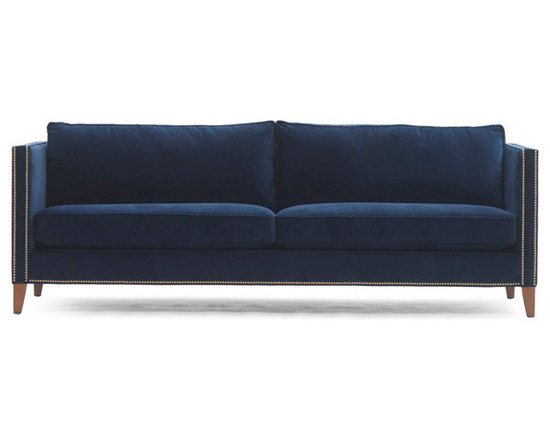 """Liam Sofa - Our Liam sofa has an updated, traditional silhouette with clean modern lines. This tailored, shelter arm style sofa has tall, slim arms, and double nail head trim wraps around the back of the sofa so it looks good from all angles. The high tapered legs """"lift"""" the sofa off the floor."""