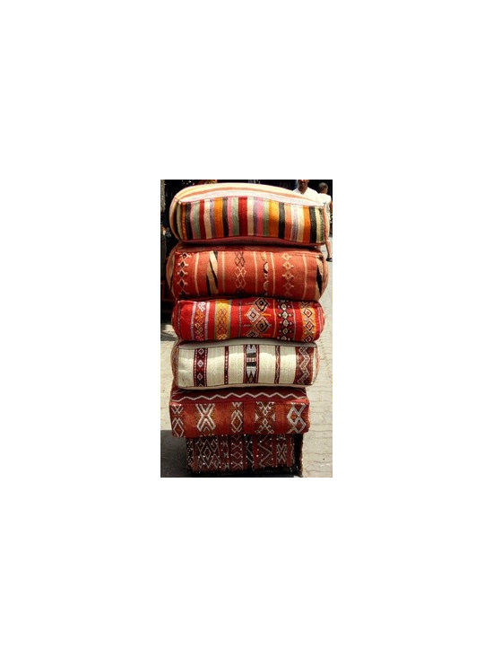 Moroccan Poufs imported from Morocco - Moroccan Wool Floor Poufs. Huge one of a kind extraordinary floor cushions made from vintage 100% wool Moroccan carpets. Dimensions 30 x 30 x 8. sizes vary. Zipper closure and down inserts.