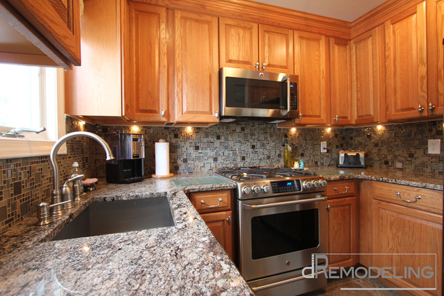 Natural Oak Cabinets With Glass Mosaic Backsplash