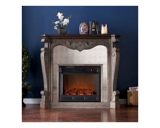 Arturo - This fireplace featuring an antiqued mirror that frames the firebox can be moved to add fiery flair to any room.