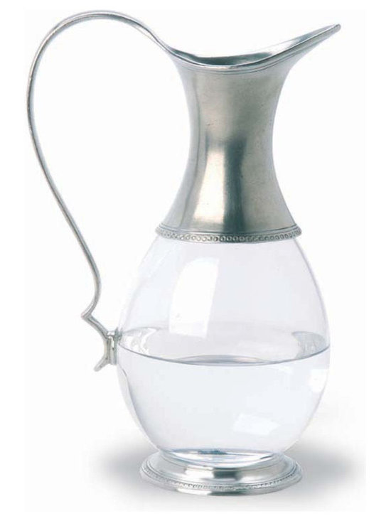 Match Glass Pitcher - This pewter glass pitcher by Match is gracefully designed with simple and elegant lines. Measures 10 h. Match stemware and barware must always be washed by hand. Please do not soak these items in hot water or place them in the dishwasher. This will compromise the bond between the crystal and the pewter, and possibly lead to separation.
