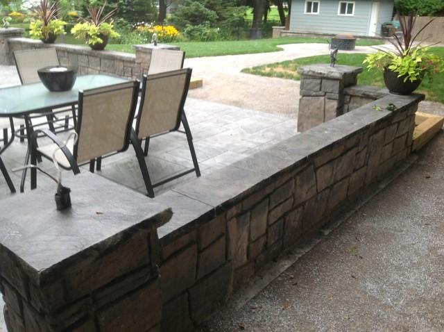 Poured Concrete Retaining Walls : Backyard patio with poured concrete retaining wall