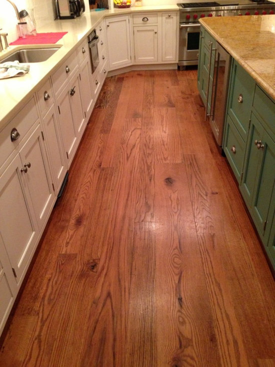 """Appalachian Red Oak - Historic Flooring's Red Oak is character rich and full of solid dark knots with a fair amount of wormholes. Red Oak is a strong, sturdy wood that resists wear and tear. The reddish orange patina is a perfect complement to the golden browns found in other wood patinas. The coarse grain and porous nature allows our Red Oak to take stain very well. Ask us about the """"wormy"""" version of Red Oak that has all the same traits as classic Red Oak with 80% wormholes -- either way, you'll be thrilled with the beauty and character of this wood."""