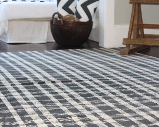 Black/White Gingham Cotton Rug - Our cotton rug is a must for every home. This durable design has a timeless gingham pattern that will liven any space. It's also reversible and washable, so it's a fine candidate for high-traffic zones.