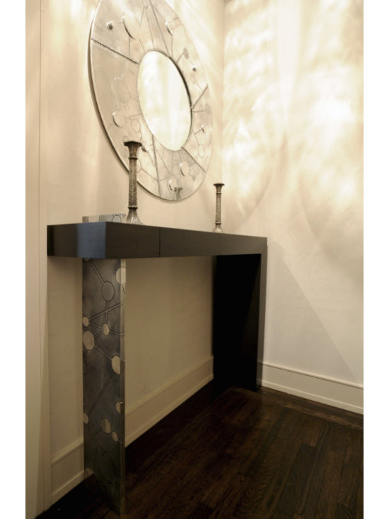 Etched Console - This client had purchased a beautiful mirror and wanted a console to match it. We customized this console for them to have an etched aluminum pedestal matching the design of the mirror. This entry console has two concealed drawers which were made in rift oak finished with dark stain.
