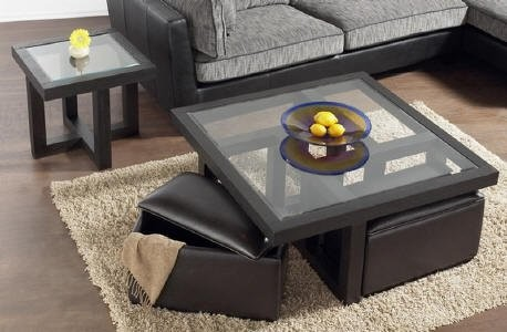 my favorite so far. glass coffee table with ottomans underneath