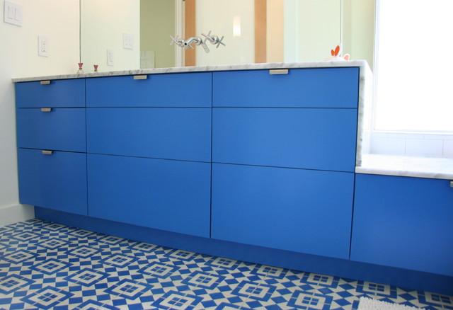 IKEA cabinets in custom blue lacquer facing contemporary bathroom