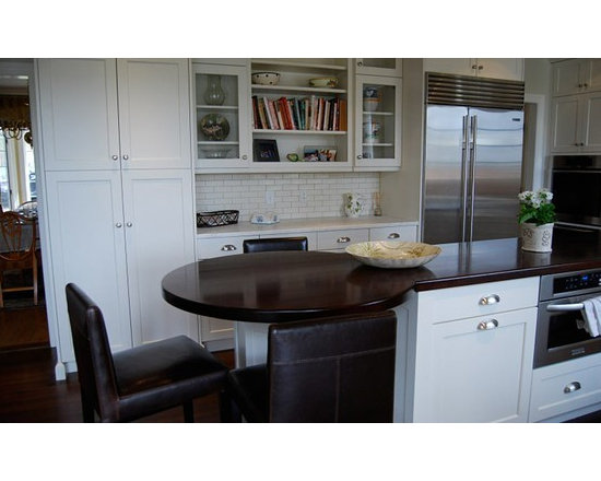 Walnut Kitchen Island Countertop and bar. Designed by Ulrich Inc. - http://www.glumber.com/