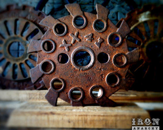 """Antique Industrial Gear Decor - Here's a fantastic 1800's gear of cast iron in a hardcore industrial design. Very old, very rare. Dimensional text to make it even more intriguing! Rusty, very aged patina. Sits in a rustic reclaimed lumber display stand. 5.5"""" diameter."""