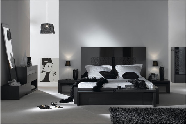 Bedroom with Gray Walls Black Furniture 640 x 426