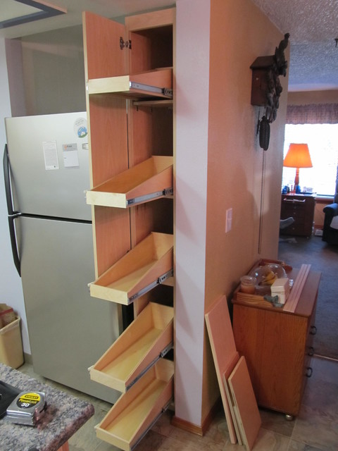 pull out shelves for a narrow pantry pantry cabinets. Black Bedroom Furniture Sets. Home Design Ideas