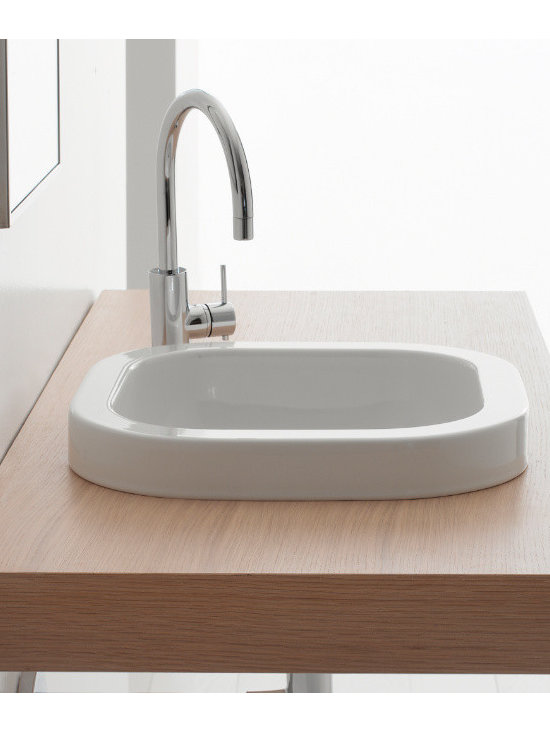 "Scarabeo - Gorgeous Square Built-In White Ceramic Sink by Scarabeo - Gorgeous square contemporary built-in bathroom sink in white ceramic. Stylish sink comes without overflow and has no faucet holes. Designed and manufactured in Italy by Scarabeo. Sink dimensions: 15.80"" (width), 5.20"" (height), 15.80"" (depth)"