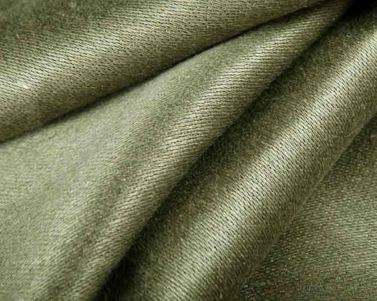 Sateen Weave Reversible Fabric in Willow Green - Sateen Weave Reversible Fabric in Willow Green is a 100% Belgian Linen in a soft grey-green colorway with a smooth texture. Great for upholstery, drapery, or pillows. Width: 56″.