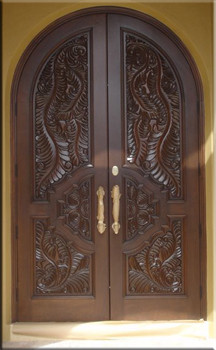 Custom Carved Entry Doors tropical-front-doors