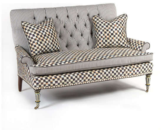 Courtly Check Underpinnings Loveseat | MacKenzie-Childs - Mingling Courtly Check® and ticking stripes, the stage is set for a lively exchange of ideas. Made in the U.S., the loveseat features an eco-friendly frame of sustainably harvested hardwood and eight-way hand-tied coil construction for outstanding comfort. Antique brass nailhead trim and castered legs. Includes two reversible Courtly Check®/ticking stripe pillows. All green-manufactured in our commitment to domestic manufacturing and responsible practices.