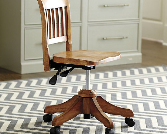 Ballard Designs - Ellison Desk Chair - Petite size. Crafted of hardwood. Antique finish. Castered 5-spoke legs for easy movement. It has the classic looks of a vintage office chair, but our Ellison Desk Chair is designed with lots of thoughtful modern features. Comfortable saddle shaped seat adjusts in height while the overall silhouette remains petite. Back reclines or locks into position. Ellison Desk Chair features: . . . .