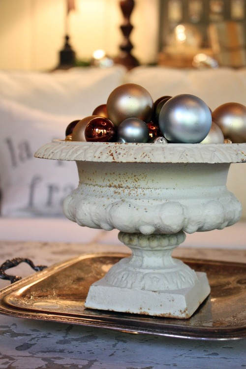 Christmas ornaments inside a ceramic urn
