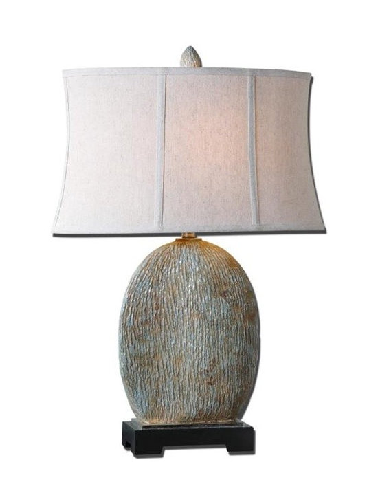 Uttermost Seveso - Textured ceramic base finished in a light blue glaze with a light rust wash and antiqued silver accents. The oval semi drum shade is an oatmeal linen fabric with natural slubbing.