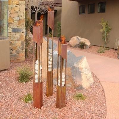 Elements Fire Torch modern-outdoor-lighting