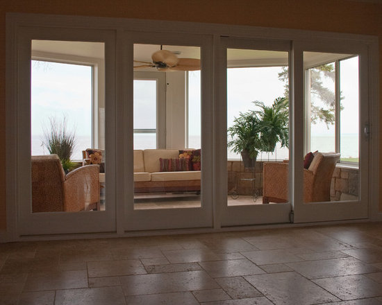 """Considering Carpet? Roll Out the Stone Instead! - Sunroom.  NSVI """"Windsor"""" stone travertine floor."""