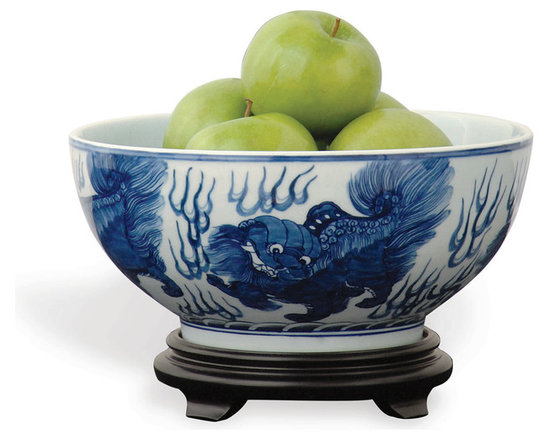 Port 68 - Chow Blue Bowl - Function meets style in this hand-painted porcelain bowl. Brighten your kitchen countertops with the Chow Blue Bowl, the perfect decorative piece for displaying an array of fruits and vegetables. Featuring an intricate dragon design, blue edging and a black base, this bowl complements a variety of home decor.