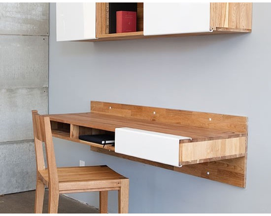 MASHstudios Wall Mounted Desk - Perfect for small spaces, this Desk by MASHstudios attaches to the wall and makes legs seem like pointless obtrusions. Convenient cubbies underneath do away with drawers, allowing for quick stowing and access.