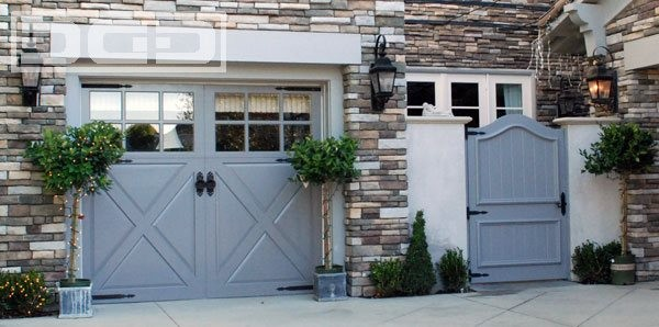 Custom Carriage House Garage Doors With Decorative French Hardware traditional garage and shed